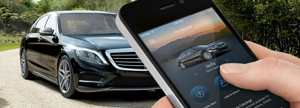MBUSA technology MB vehicle exterior front fascia and passenger side with smartphone in the forefront
