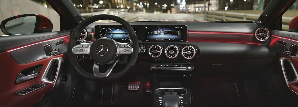 2019 MB A-Class interior front cabin steering wheel and touchscreen display red ambient lights