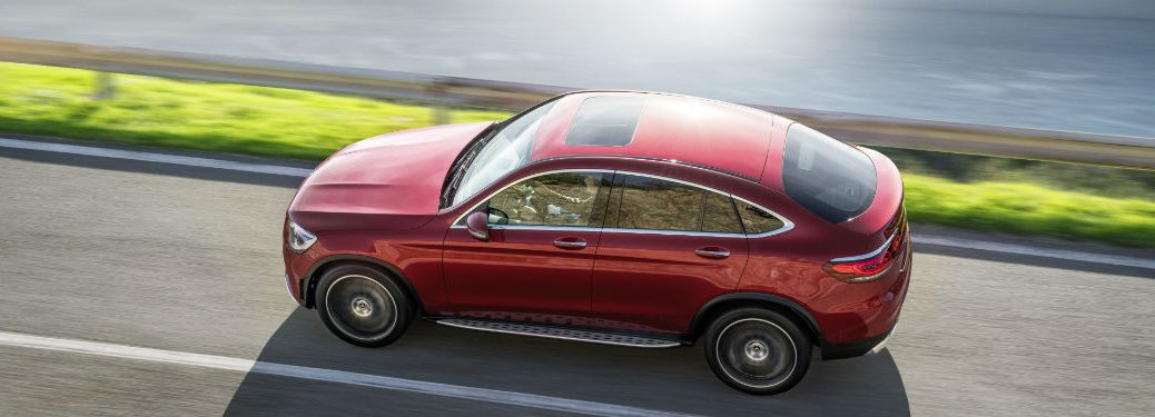 2020 MB GLC Coupe exterior top view of roof and drivers side going fast on road and water