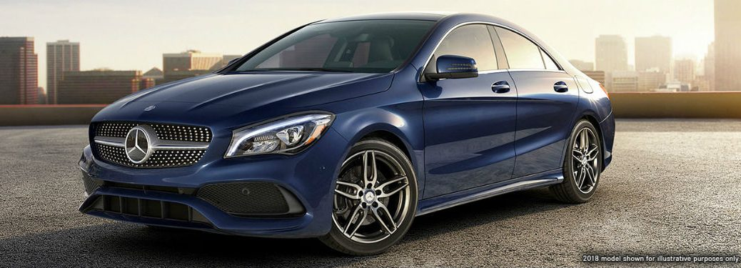2019 MB CLA Coupe exterior front fascia and drivers side parked in empty lot with city background