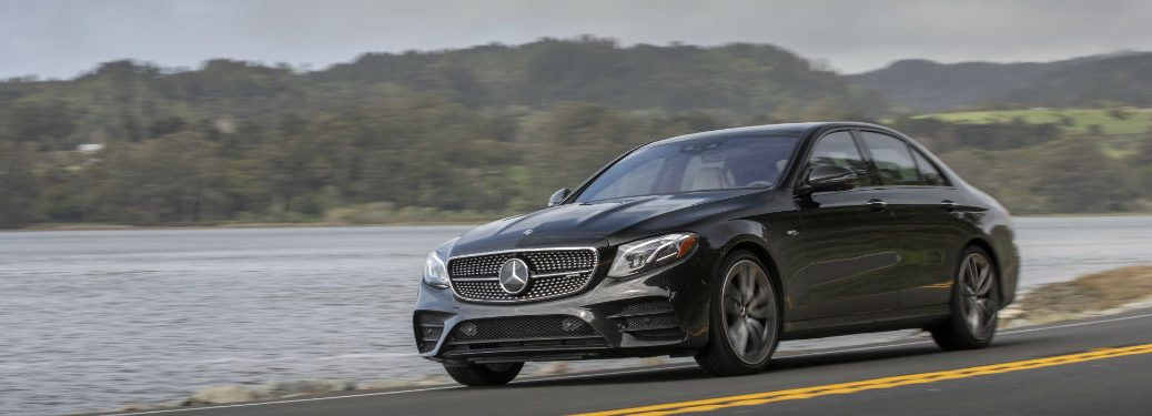 2019 MB E-Class exterior front fascia and drivers side going fast on lakeside road