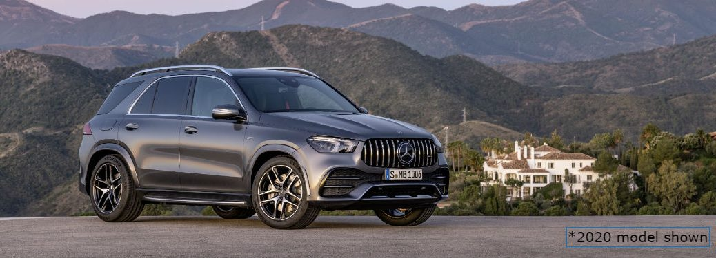 2020 MB GLE SUV exterior front fascia and passenger side on lot overlooking mountains