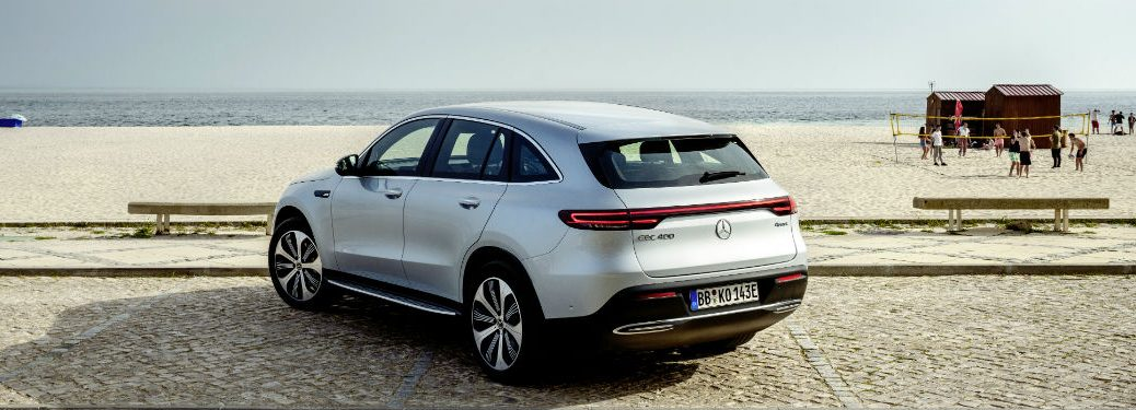 2020 Mercedes-Benz EQC 1886 exterior back fascia and driver side on beach