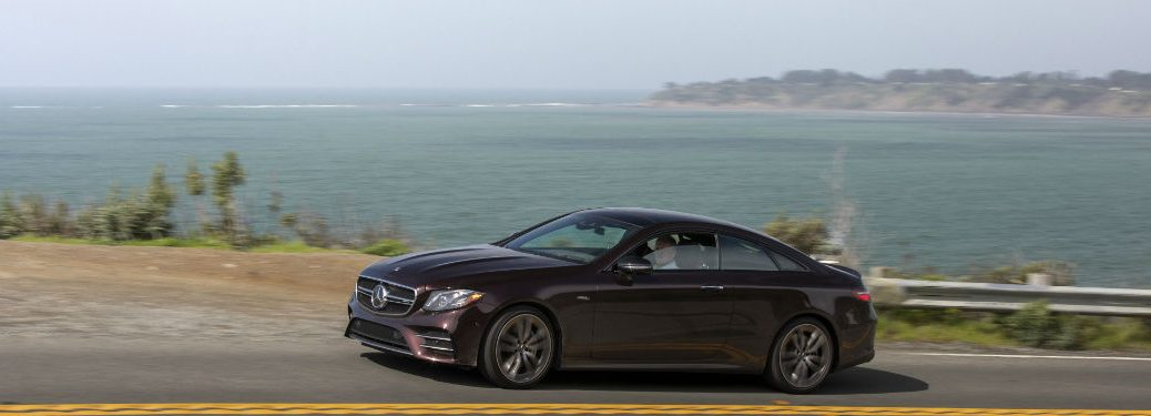 2019 MB E-Class going fast on lakeside highway on an overcast day