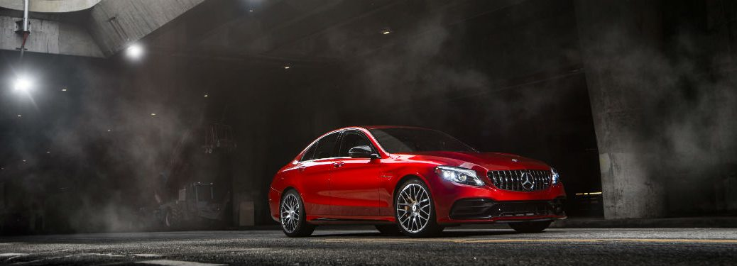 2019 MB AMG C-Class exterior front fascia and passenger side in dark room