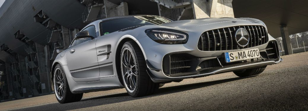 2020 MB AMG® GT R PRO exterior front fascia and passenger side in front of building