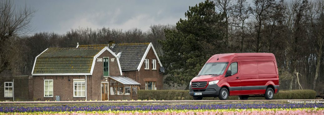 2019 MB Sprinter exterior front fascia and driver side in front of farmhouse
