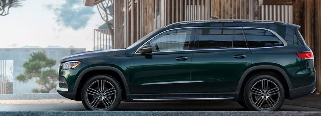 2020 MB GLS exterior driver side profile in front of wood building