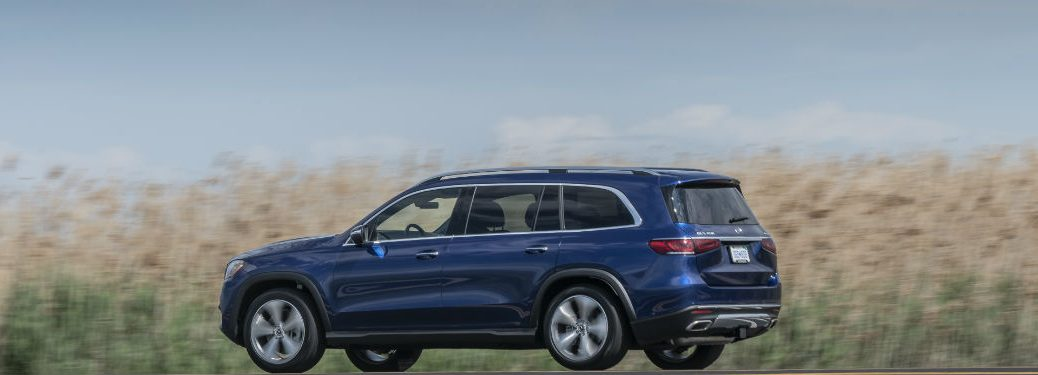 2020 MB GLS exterior back fascia and driver side in front of blurred corn field