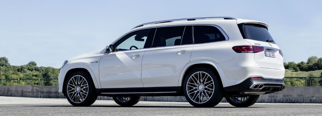 2020 MB AMG GLS exterior back fascia and driver side in empty lot in front of trees
