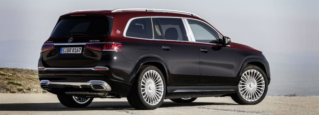 2021 MB Maybach GLS exterior back fascia and passenger side in front of hazy city