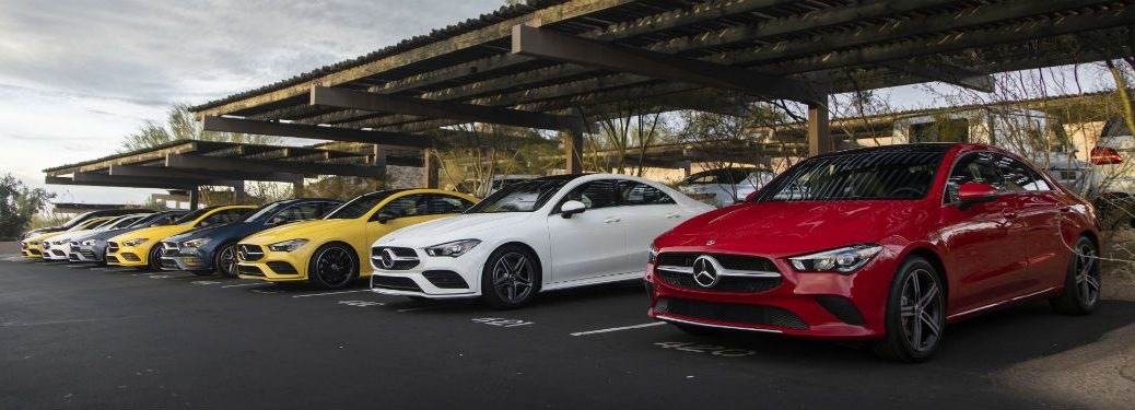 lineup of 2020 MB CLA Coupe models underneath overhang