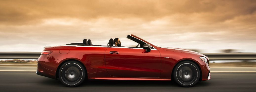 2019 MB E-Class Cabriolet exterior passenger side on blurred highway