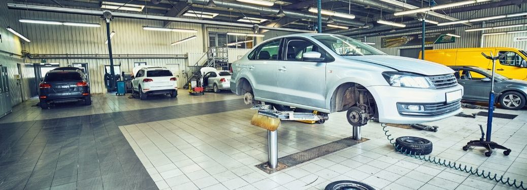 Car lifted in service center