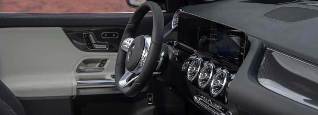 Close up of steering wheel and dashboard in a Mercedes-Benz