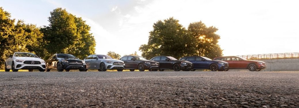 lineup of the 2021 Mercedes-Benz E-Class models exterior front fascias with trees