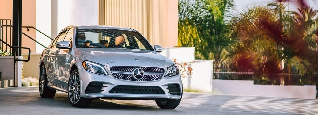 2021 Mercedes-Benz C-Class Sedan parked in front of nice house