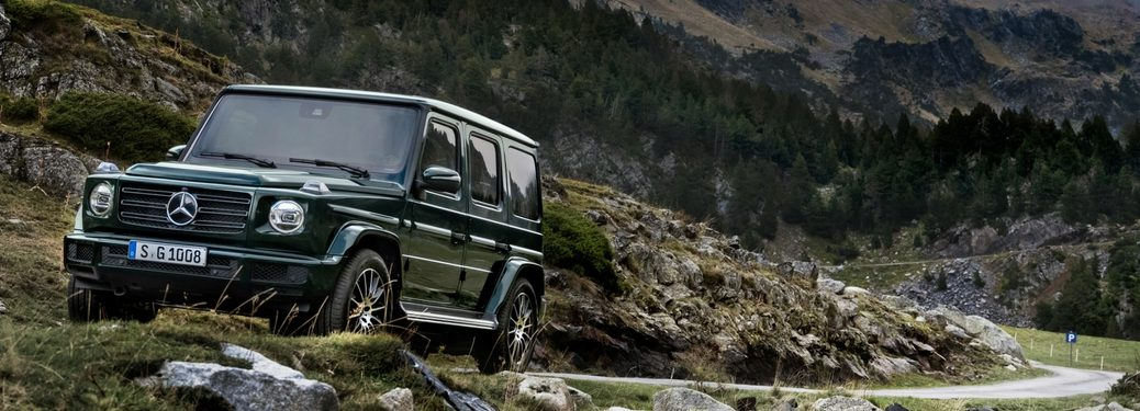 new 2019 mercedes-benz g-class driving through mountains and fog