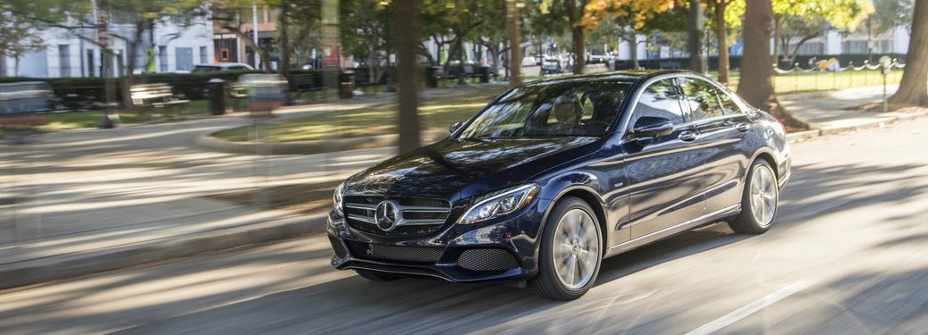 2018 Mercedes-Benz C350e Sedan driving down street
