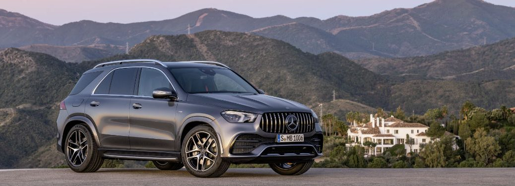 2021 MB AMG GLE 53 exterior front fascia passenger side on hill with mansion in distance