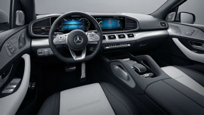 2020 MB GLE interior front cabin partial seats steering wheel touchscreen display and dashboard