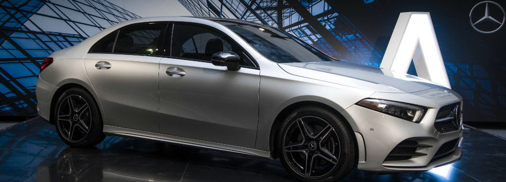 2019 MB A-Class exterior front fascia and passenger side with A and MB icon in background