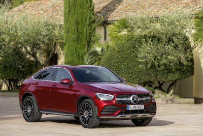 2020 GLC Coupe exterior front fascia and passenger side in empty lot in front of bushes
