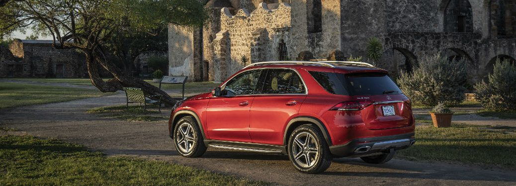 2020 MB GLE SUV exterior back fascia and drivers side in front of castle with trees and grass