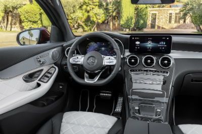 2020 MB GLC Coupe interior front cabin steering wheel dashboard with house and trees in windows