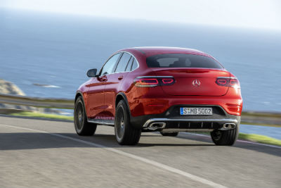 2020 MB GLC Coupe exterior back fascia and drivers side going fast on seaside road