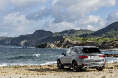 2020 MB GLC Coupe exterior back fascia and drivers side parked on the beach with distant mountains