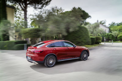 2020 MB GLC Coupe exterior back fascia and passenger side on lot next to house and trees