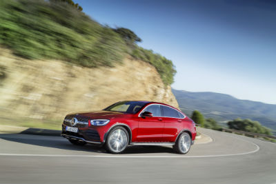 2020 MB GLC Coupe exterior front fascia and drivers side on blurred winding road