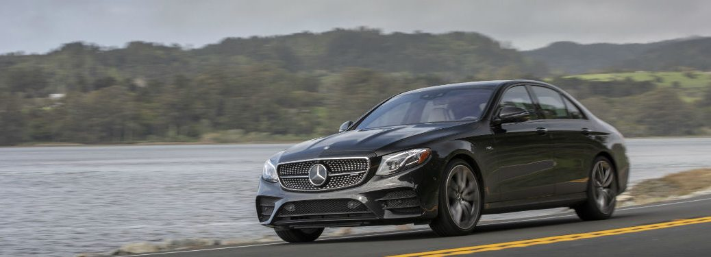 2019 MB E-Class sedan exterior front fascia and drivers side on road next to lake