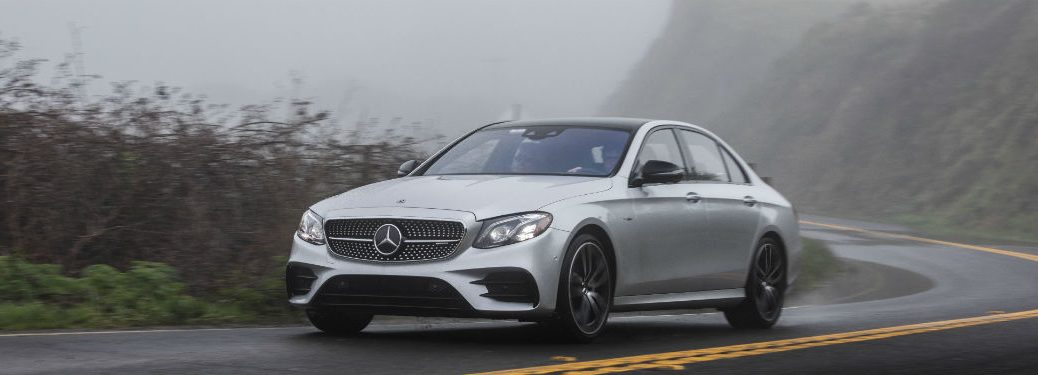 2019 Mercedes Benz E-Class exterior front fascia and drivers side on foggy winding road