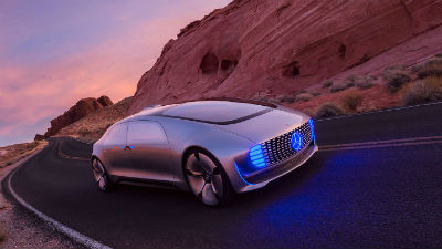 2020 F 015 exterior front fascia and passenger side with blue lights in front on desert road