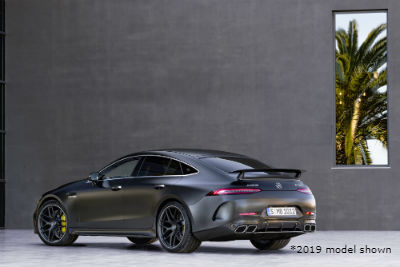 2019 MB GT 4-Door Coupe exterior back fascia and driver side in gray room with palm tree in window