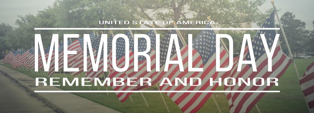 Memorial Day remember and honor banner over flags on grass