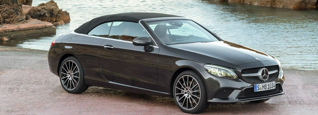 2019 MB C-Class Cabriolet exterior front fascia and passenger side parked next to water