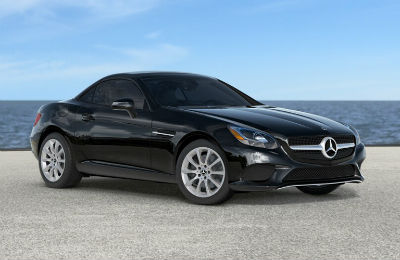 2019 MB SLC Roadster exterior front fascia and passenger side parked in empty lot next to water