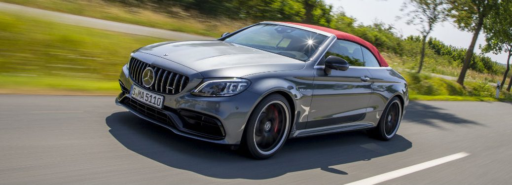 2019 MB AMG 63 S exterior front fascia and driver side going fast on blurred country road