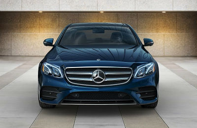 2019 MB E-Class exterior front fascia parked on tiled surface with tile wall behind it