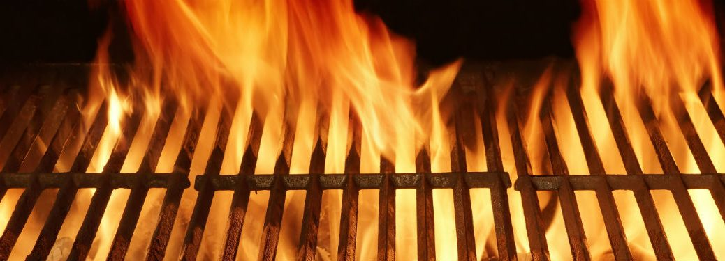 Empty bbq grill with large flames