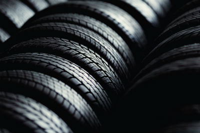 close up of a row of tires with dramatic lighting