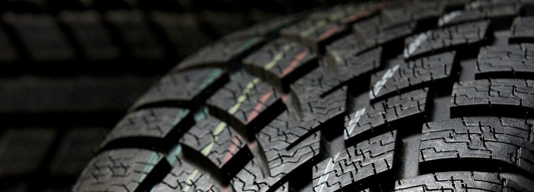 close up of tread on a tire with dramatic lighting
