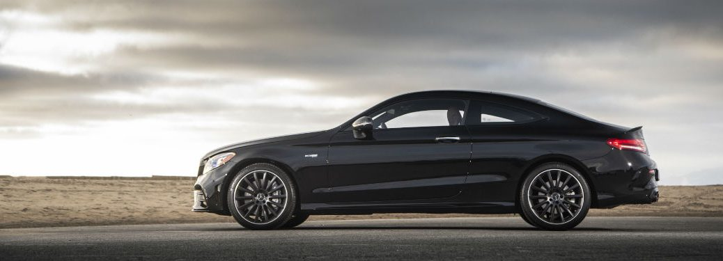2019 MB C-Class Coupe exterior driver side profile on empty desert road