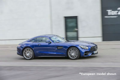 2020-Mercedes-Benz AMG GT exterior front fascia and passenger side going fast on town road