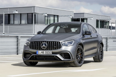 2020-MB-GLC-SUV-exterior-front-fascia-and-driver-side-in-front-of-large-house_o