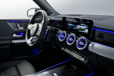 2020 MB GLB interior front cabin steering wheel and display screen with blue ambient lighting