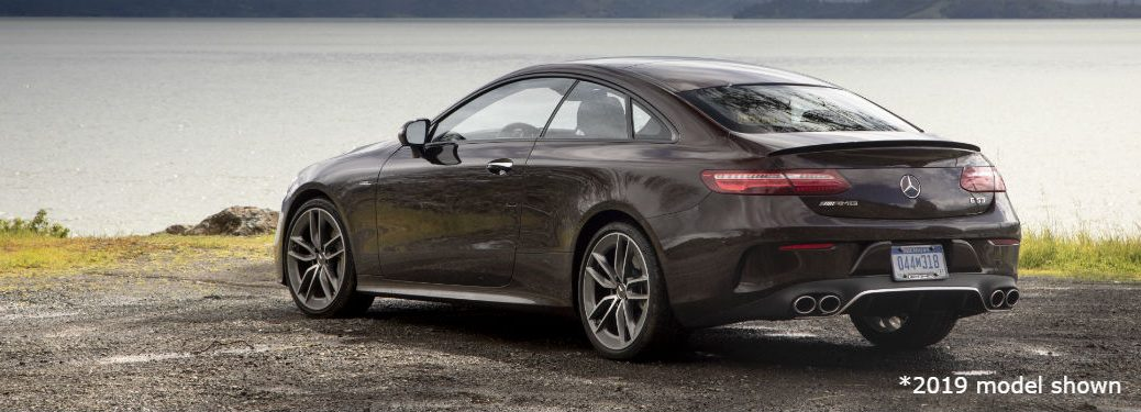 2019 MB E-Class Coupe exterior back fascia and driver side in front of lake